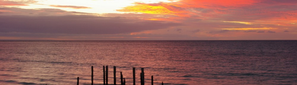 Sunset over jetty ruins